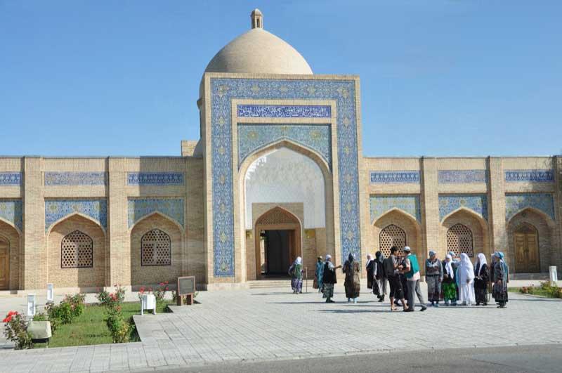 Locals gather outside the Bahauddin Naqshband Mausoleum near Bukhara. Photo credit: Russ & Ellen Cmolik