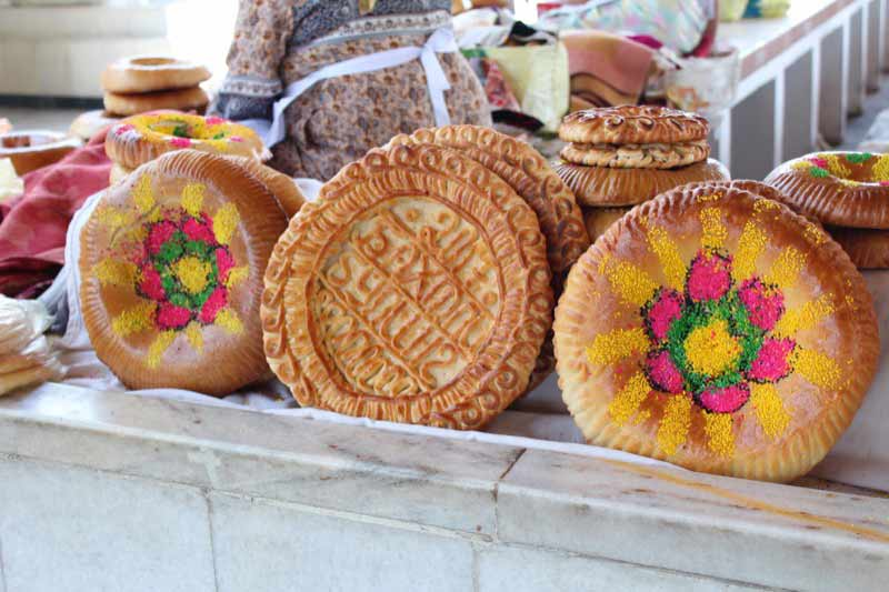 Specially-decorated breads grace the bazaars of Uzbekistan at Navruz. Photo credit: Willis Hughes