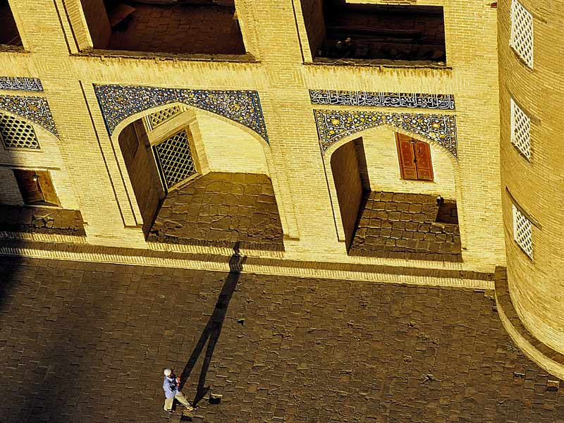 A lone shadow amid the ancient architecture of Central Asia. Photo credit: Peter Guttman
