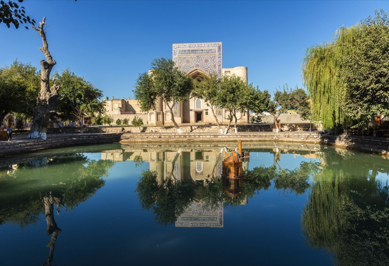 Bukhara's Lyabi-Hauz is an oasis within a Silk Road oasis, for centuries a place to meet, eat, and relax. Photo credit: Abdu Samadov