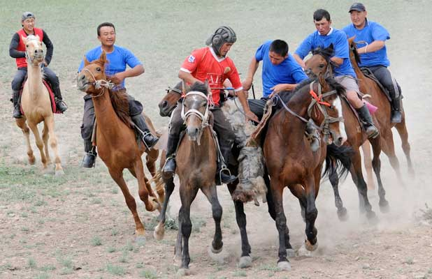 Competitors tussle in a lively Kyrgyz horse game similar to polo. Photo credit: Christine Z. Anderson