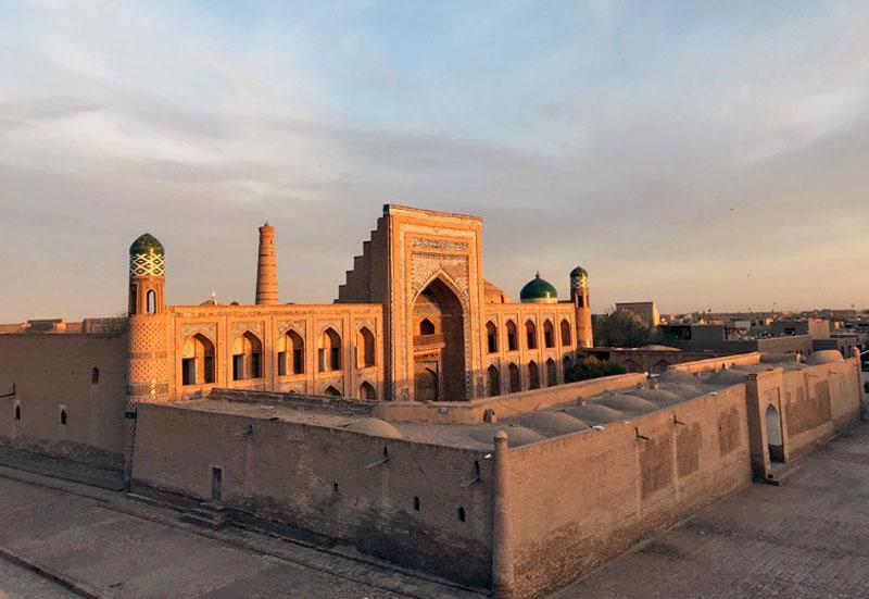 Sunlight highlights the magnificent blue majolica entrance portal of Muhammad Rahim-Khan Madrassah. Photo credit: Abdu Samadov