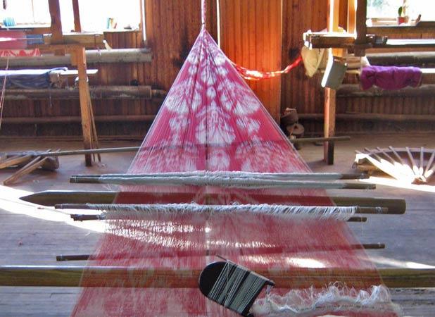 A silk loom stretches from wall to wall in Margilan, Uzbekistan. Photo credit: Paul Schwartz