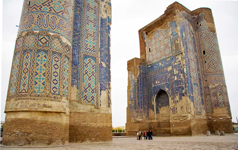 Once 65 meters tall, only parts of the blue, gold, and white mosaic Ak Saray Palace gate towers remain, under UNESCO protection. Photo credit: Jens Frank