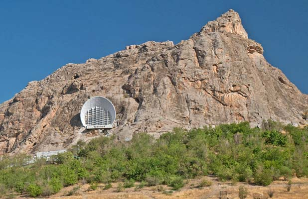 A museum is built into the side of UNESCO-listed Sulaiman-Too Sacred Mountain. Photo credit: Richard Fejfar