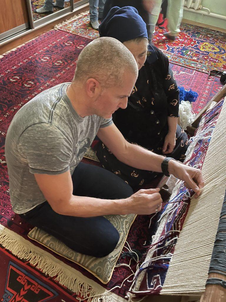 John learning to weave a carpet in Dagestan. Photo credit: John Seckel