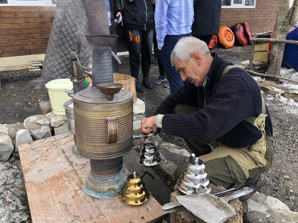 Preparing tea from a samavar in Dagestan, Russia. Photo credit: John Seckel