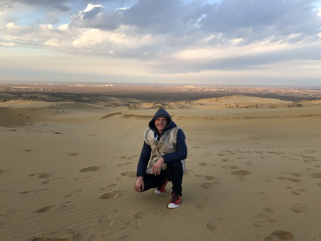 Exploring the Sarykum sand dune in Dagestan, Russia. Photo credit: John Seckel