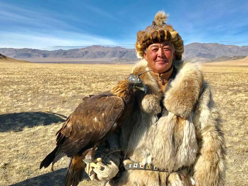 A Kazakh berkutchi, or eagle handler, and his hunting companion. Photo credit: Michel Behar