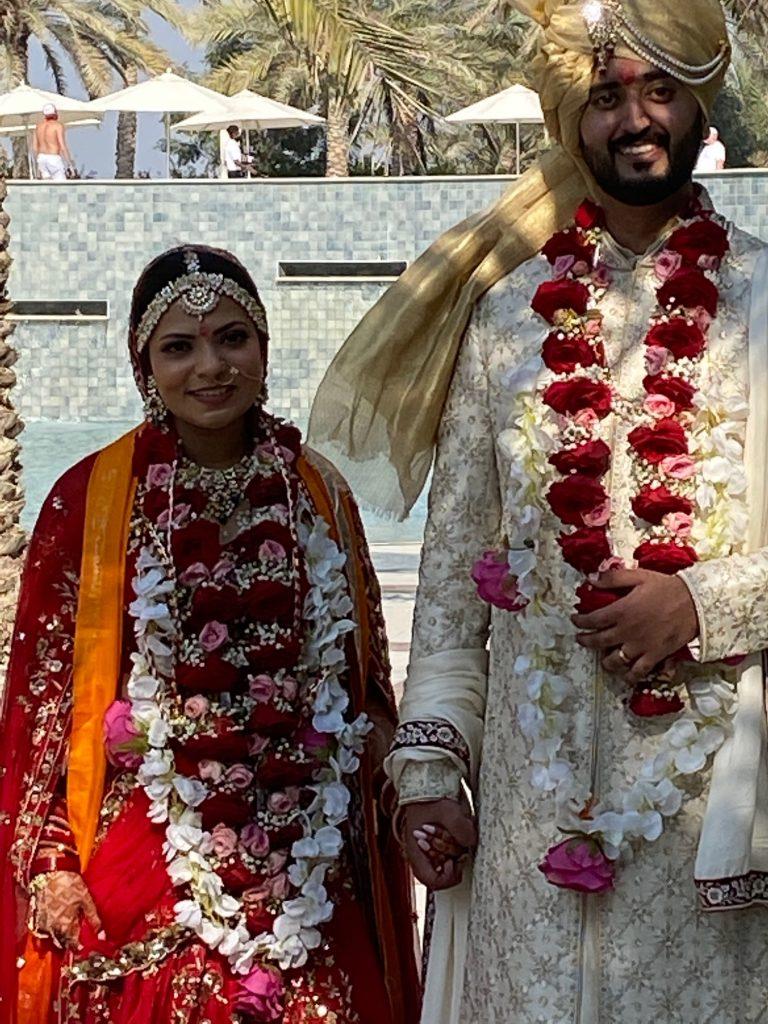 The happy couple of an Indian wedding at the Hilton Ras Al Khaimah Resort, UAE. Photo credit: Luba Rudenko