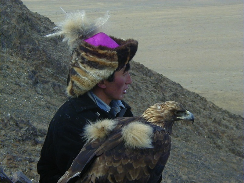 A fox-fur hat and an eagle ready for take-off in Mongolia. Photo credit: Nomadic Expeditions