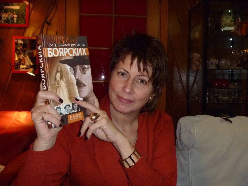 "A photo of Katya holding up her book, ""The Boyarsky Theater Dynasty."" Photo credit: Liz Riley"