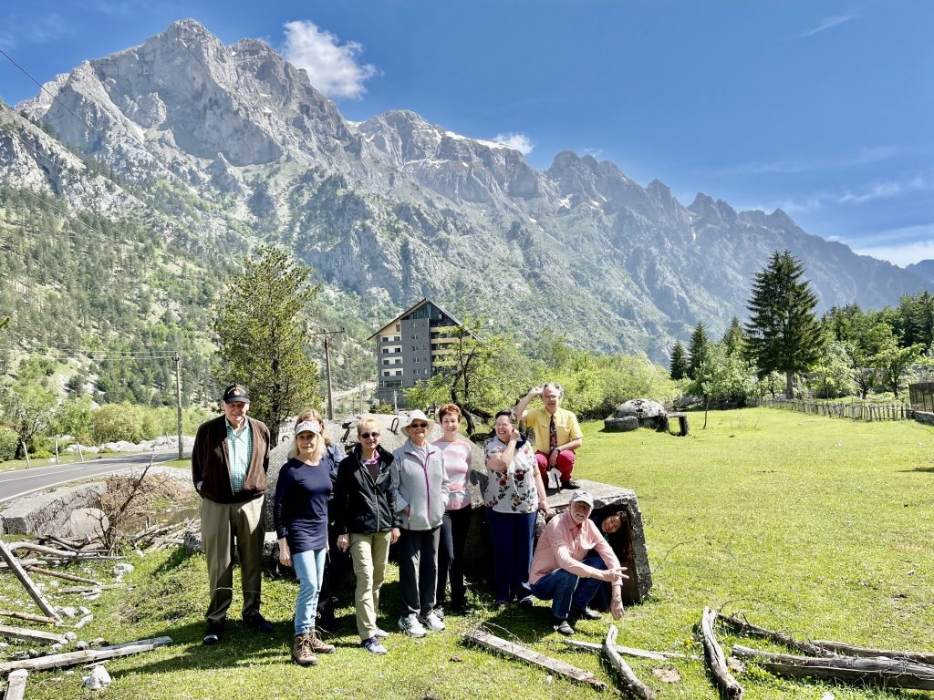 Group photo with a bunker and breathtaking mountain peaks at the background. Photo credit: Michel Behar